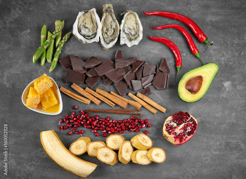 Different aphrodisiac food for increasing sexual desire on gray table Canvas Print
