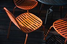 Orange Chairs In Dark Scene