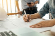 Engineer of architect starting draw a house blueprint on the desk in the office at construction working site and Engineering tools