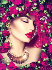 FototapetaBeauty model girl with pink roses flower wreath and fashion make up. Flowers hairstyle