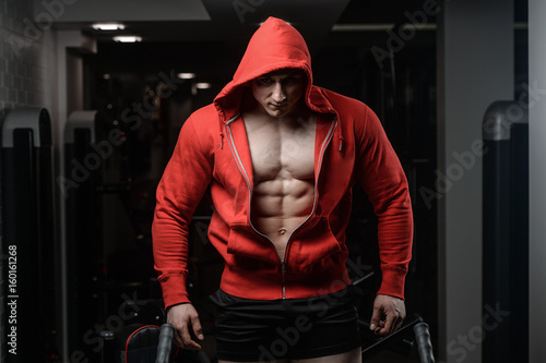 Strong Athletic Man Fitness Model in a hood Torso showing six pack abs Plakát