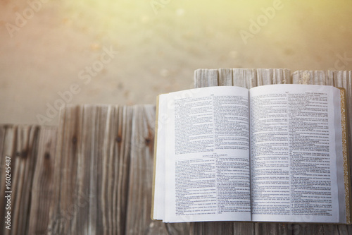 Bible at beach with copy space