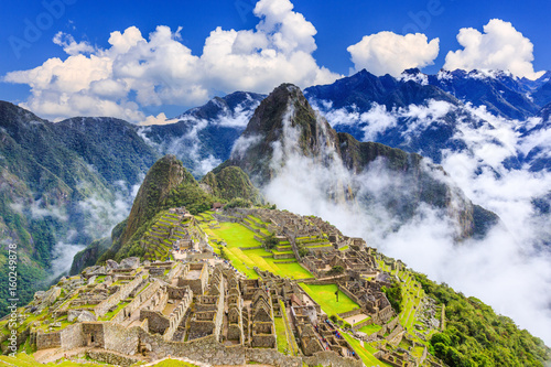Photo Stands South America Country Machu Picchu, Peru. UNESCO World Heritage Site. One of the New Seven Wonders of the World
