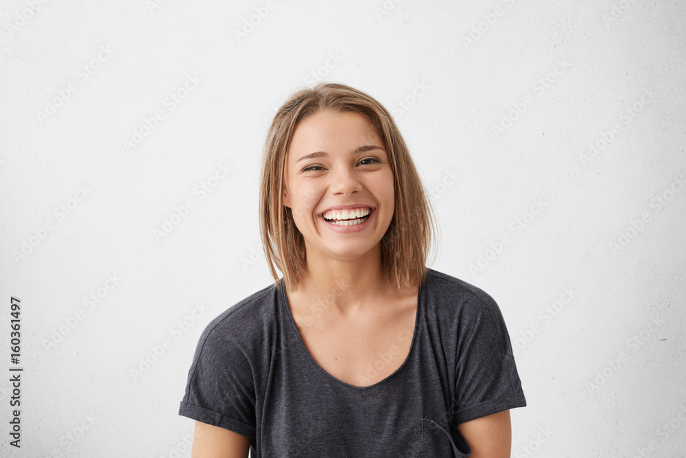 Fototapety, obrazy: Attractive woman with short fair hair being very glad smiling with broad smile showing her perfect teeth having fun indoors. Joyful excited cheery femlae rejoicing after being proposed to marry