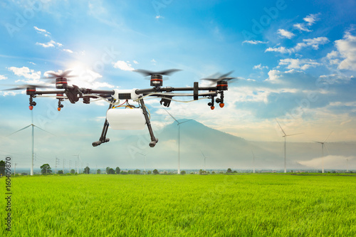 Agriculture drone flying on the green rice field