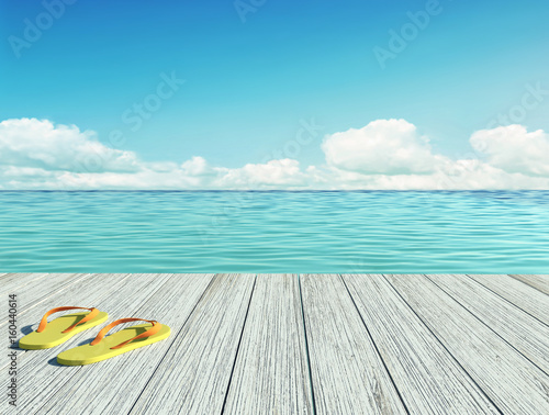 Yellow flip flops on a wooden floor by the seashore