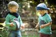 canvas print picture - zwei Kinder spielen mit Stöcken