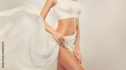 Fotografia Slim tanned woman Perfect Body