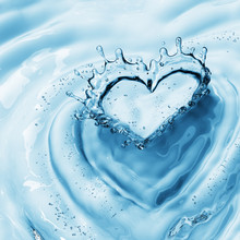 Heart From Water Splash With Bubbles On Blue Water Background