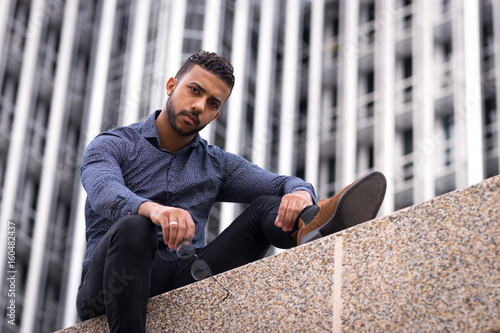 Fototapety, obrazy: Black male portrait against chopped looking at camera