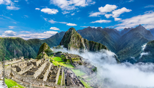 Photo Stands Historical buildings Overview of Machu Picchu, agriculture terraces and Wayna Picchu peak in the background