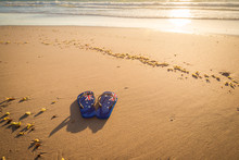 Aussie Thongs On The Beach At Sunset