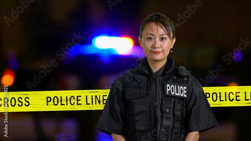 Canvas Print Asian American Policewoman smiling at camera