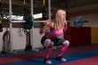 Young Woman Doing Exercise Front Squat