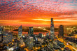 Leinwanddruck Bild - Aerial view of beautiful sunrise over high building and business centre of Ho Chi Minh City - The biggest city in Vietnam