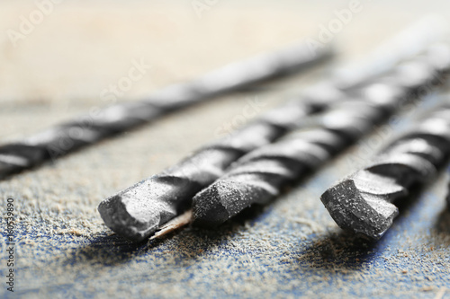 Papiers peints Retro Set of drills on wooden table, closeup