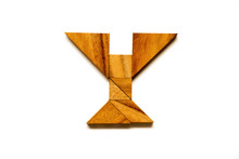 """Wooden Tangram Puzzle As English Alphabet Letter """"Y"""" Shape On White Background"""