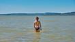 Beautiful girl bathing in Balaton lake