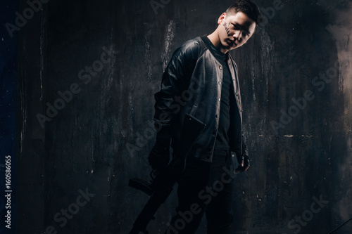 Tattooed Killer With Sniper Rifle In Black Cloth Studio Shoot Armed White Gangster Man