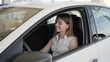 Portrait happy female customer, client get keys, key to new automobile in hand, girl with car key, woman in Auto dealership, vehicle showroom, machine sale in car