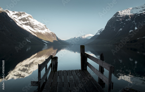 Spoed Foto op Canvas Grijze traf. Old wooden pier at the lake in Norway