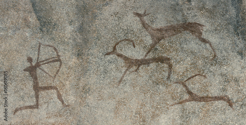 Fotomural Drawings in a cave on a wall, a rock