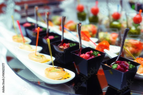 Recess Fitting Assortment Various snacks on table, toned