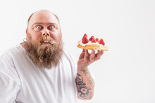 Man Holding A Dessert In His Hand