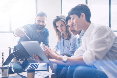 Obraz Business meeting concept.Coworkers team working new startup project at modern office.Analyze business documents, using touch tablet.Blurred background.Horizontal - fototapety do salonu