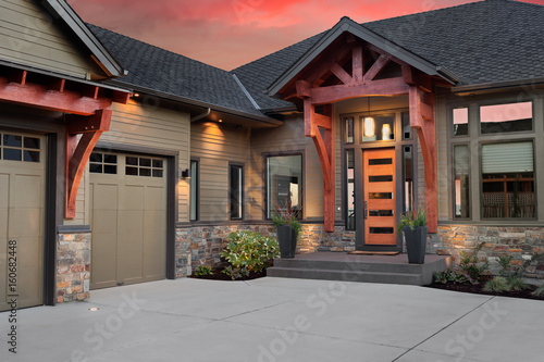 Beautiful Luxury Home Exterior At Sunset Front Entrance With Elegant Door And Partial View
