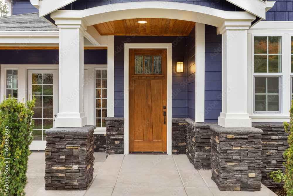 Fototapety, obrazy: New Luxury Home Exterior Detail: New House Front Door and Covered Patio with Arch, Columns, and Elegant Design