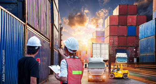 Valokuva  Forklift handling container box loading and Container Cargo freight ship with wo