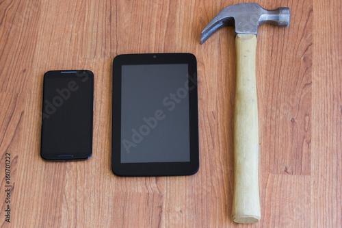 Fotografie, Obraz  Cell Phone Tablet and Hammer