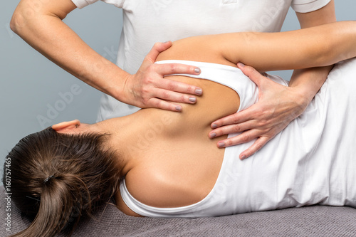 Cuadros en Lienzo  Detail of female therapist manipulating shoulder blade on patient