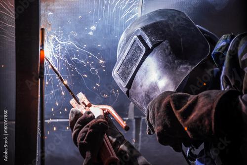Fotografie, Obraz  Arc welding of a steel in construction site