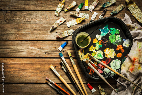 Photo Artist (painter) atelier - brushes, palette and paints on wood