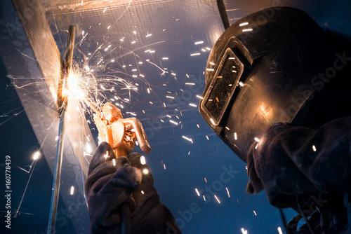 Obraz na plátně  Arc welding of a steel in construction site