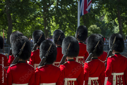 Photo Soldiers in classic red coats line up in formation on The Mall in London, England during Trooping the Colour spectacle to celebrate the Queen's birthday