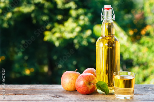apple cider in glass bottle Fototapeta