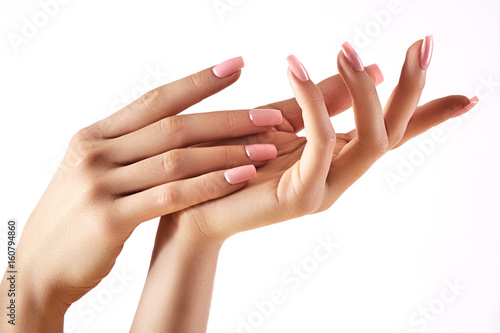 Poster Manicure Beautiful woman's hands on light background. Care about hand. Tender palm. Natural manicure, clean skin. Pink nails
