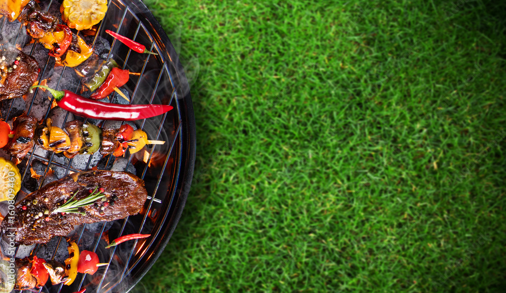 Fototapety, obrazy: Barbecue grill with beef steaks, close-up.