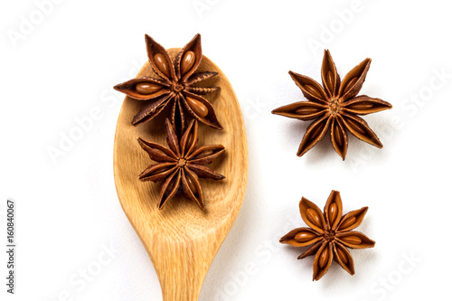Close up the brown star anise spice in wooden spoon isolated on white background Canvas Print