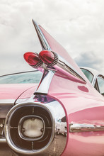 Rear End Of A Pink Classic Car