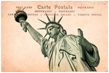 """Statue Of Liberty In New York, Collage On Sepia Vintage Postcard Background, Word """"postcard"""" Written In Several Languages"""