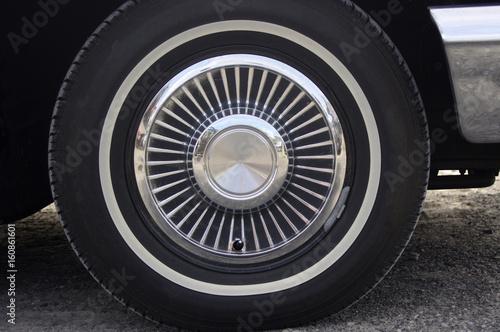 Fotografie, Obraz  Vintage car hub cap wheel