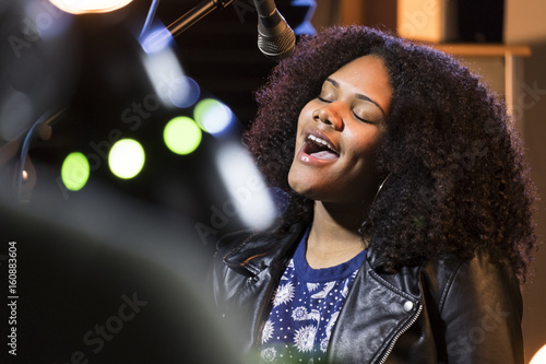 Black female singing in a recording studio Wallpaper Mural