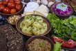 Assortment of cooked food and vegetables on the background. Top view, close up