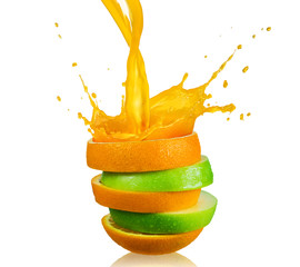 Fototapeta na wymiar green apple and splashing orange juice