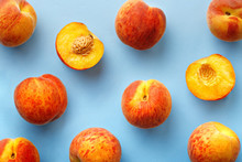 Peaches Pattern. Top View Of Fresh Fruits On A Blue Background. Repetition Concept