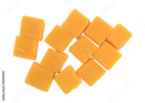 Top view of several cubes of mild cheddar cheese isolated on a white background.